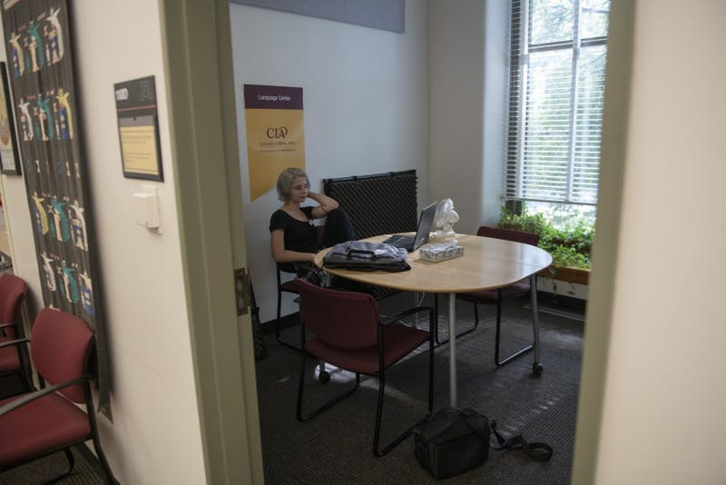Sociology senior Kali Suchy works on updating computer software at the CLA Language Center in Jones Hall on Friday, Sept. 28 on East Bank. Suchy has been working at the CLA Language Center through a work study program since her freshman year.