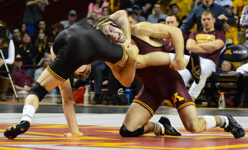Senior Chris Dardanes wrestles during his match in the Williams Arena on Friday evening, where the Gophers took on the Iowa Hawkeyes.