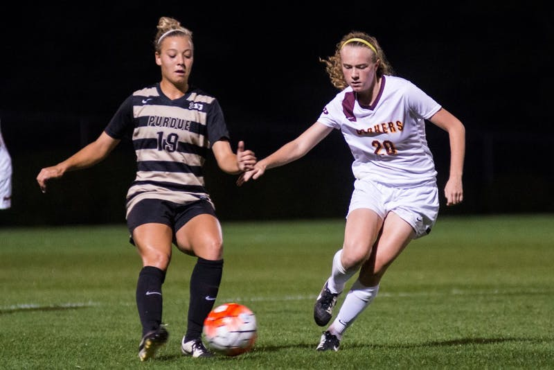 Gophers forward April Bockin fights for the ball against Purdue at Elizabeth Lyle Robbie Stadium, September 25, 2015