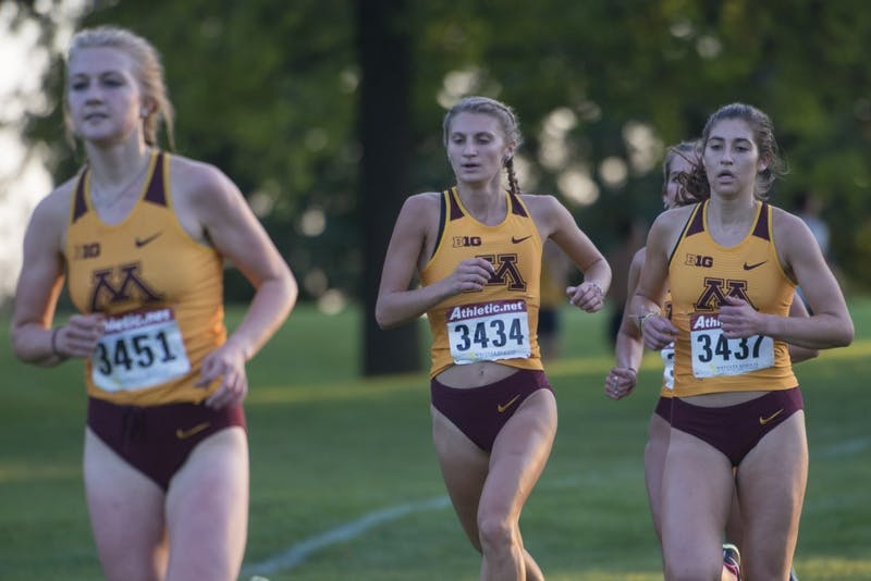 Redshirt sophomore Olivia Hummel, center, runs during the Oz Memorial on Friday, Sept. 7 at the Les Bolstad Golf Course.