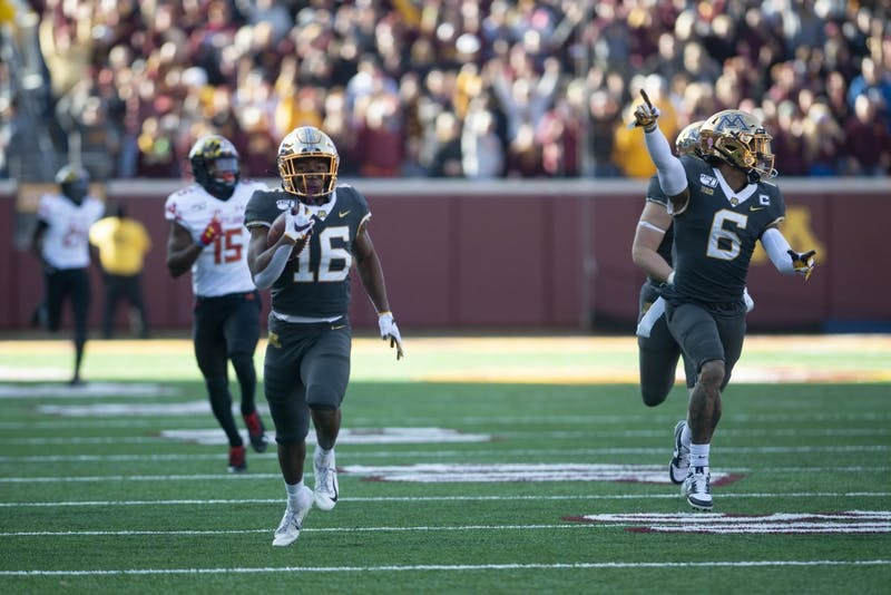Wide receiver Seth Green carries the ball down the field at TCF Bank Stadium on Saturday, Oct. 26. The Gophers defeated Maryland 52-10 bringing their record to 8-0.