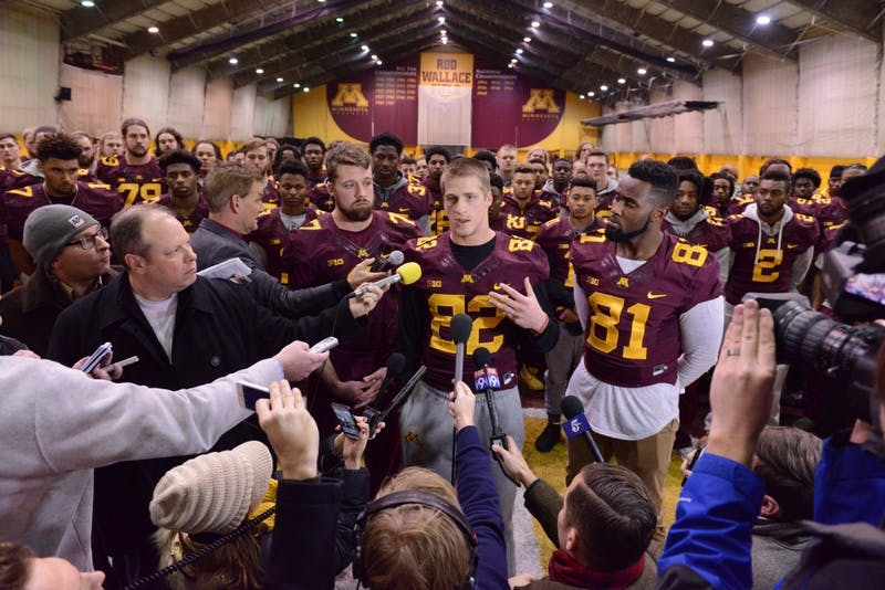 Senior wide receiver Drew Wolitarsky addresses reporters at a news conference as his teammates fill the backgroundThursday, Dec. 15 at the Gibson-Nagurski Football Complex in Minneapolis.