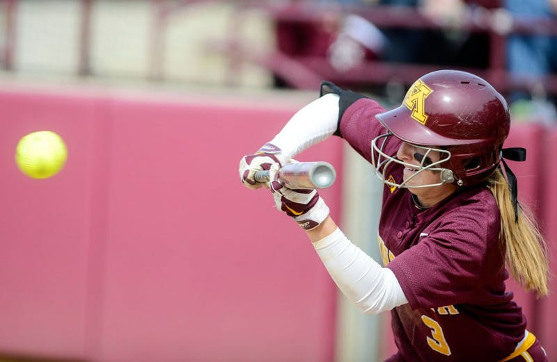 Minnesota junior Erica Meyer hits during the game against Penn State at the Jane Sage Cowles Stadium on Saturday. This game resulted in a 9-0 win for the Gophers.