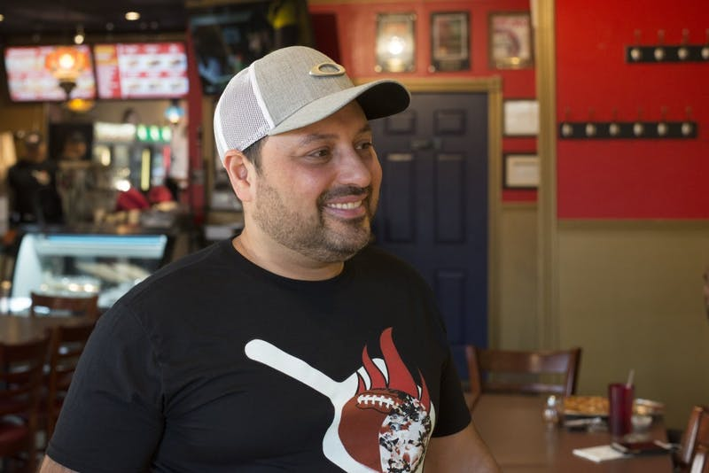 Football Pizza co-owner A.J. Azizi speaks about the history of the restaurant on Saturday, Sept. 22 in the Como neighborhood of Minneapolis.