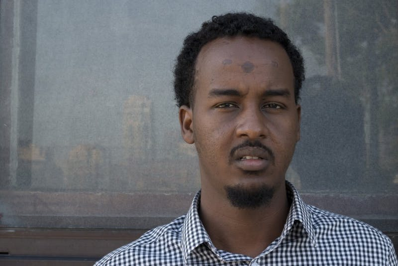 "Suud Olat, a contributor to ""A Stray"" and former Kenyan refugee, poses for a portrait on Tuesday, July 11, 2017 in the Cedar Riverside neighborhood. The 25-year-old, who is also an interpreter at St. Cloud Hospital, hopes that sharing his story through the film will improve the impression of the Somali community in Minneapolis and elsewhere."