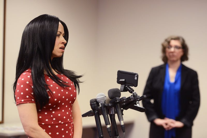 Tawnya Konobeck, an entertainer, speaks during a press conference following a city council meeting that heard a report on the workplace conditions of erotic dancers in Minneapolis strip clubs on Monday, Mar. 27, 2017. The council said it wants to begin regulating the strip club workplace for entertainers after hearing the report.