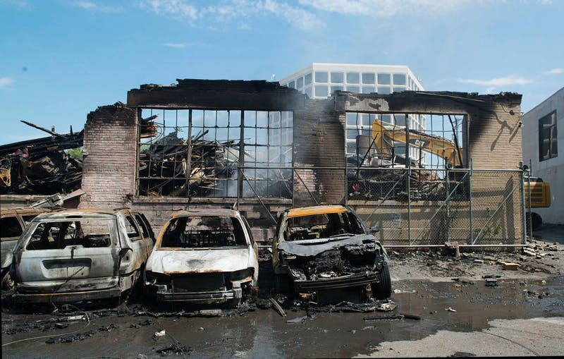 The building that caught fire early Thursday morning on University Avenue Southeast housed an auto body shop. Now, rows of burnt cars line what would have been the back wall of the shop.
