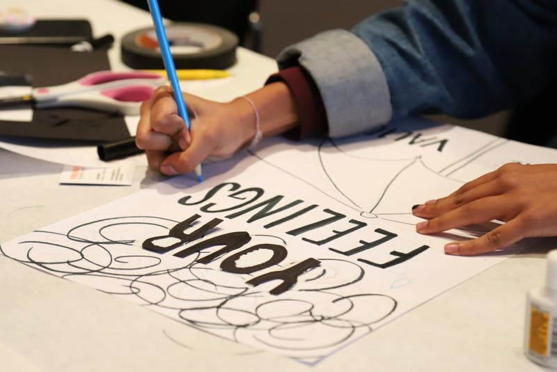 Students attend an art activist poster making hosted by Leon Wang on Friday, Nov. 16 at the Weisman Art Museum in Minneapolis.