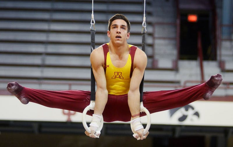 Minnesota junior Steve Jaciuk competes on the still rings at a meet against Iowa and Brockport at the Sports Pavilion on Saturday night. Saturday night was also senior night for the Men's Gymnastics Team.