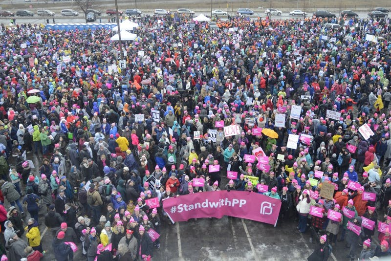 Protesters at St. Paul College wait for the Women's March to begin in St. Paul on Saturday, Jan. 21, 2017.