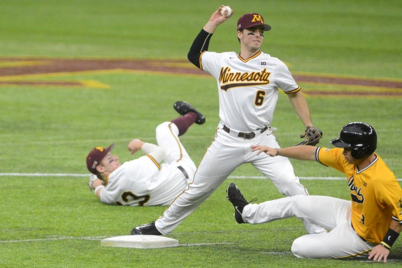Gophers shortstop Terrin Vavra turns a double play against Iowa on March 5, 2017 at U.S. Bank Stadium.
