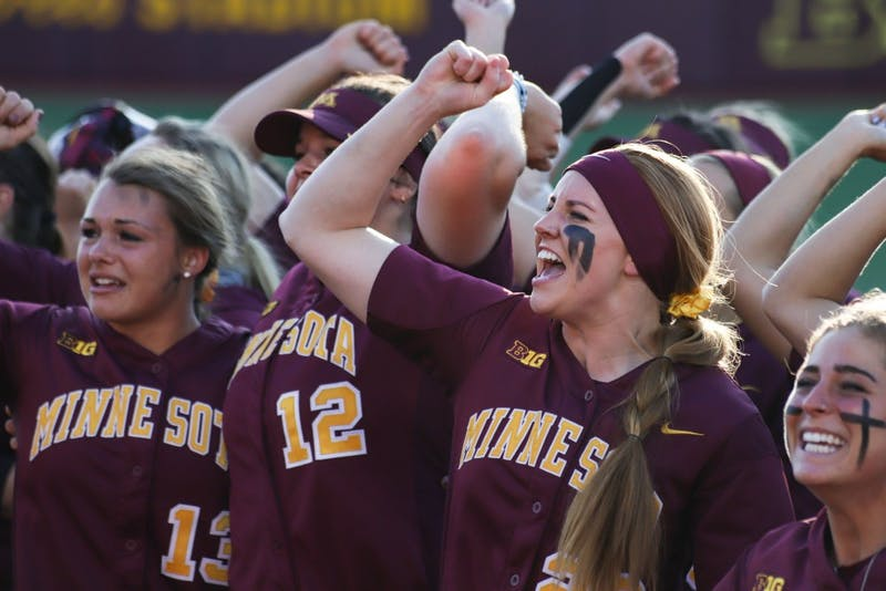 Members of the Gopher softball team celebrate after winning the game on Saturday, May 25, 2019 at the Jane Sage Cowles Stadium. The team won the NCAA Super Regional.