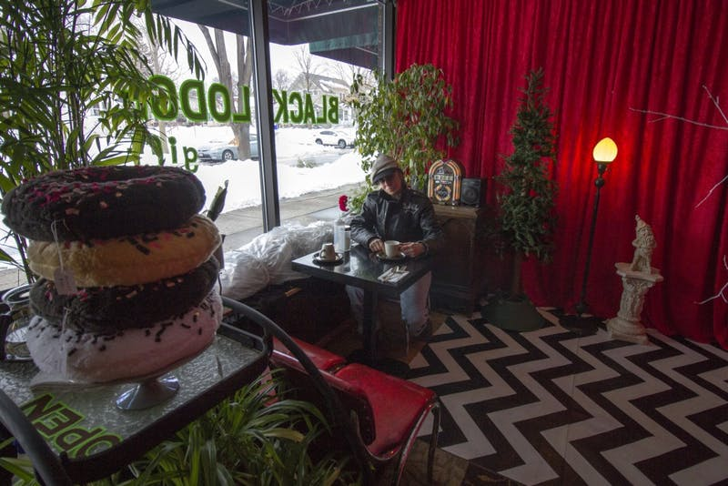"""Artist and owner Nancy Waller poses for portraits at the Black Lodge gift shop on Tuesday, March 6. The shop is themed after David Lynch's television show """"Twin Peaks."""""""