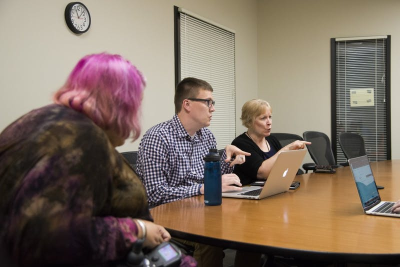 Corbett Laubignat, left, Chris Luhmann and Barb Podesta at a Disabled Employees at the U meeting on Tuesday, Sept. 3. The group aims to build an inclusive and accessible community led by and for disabled University employees.