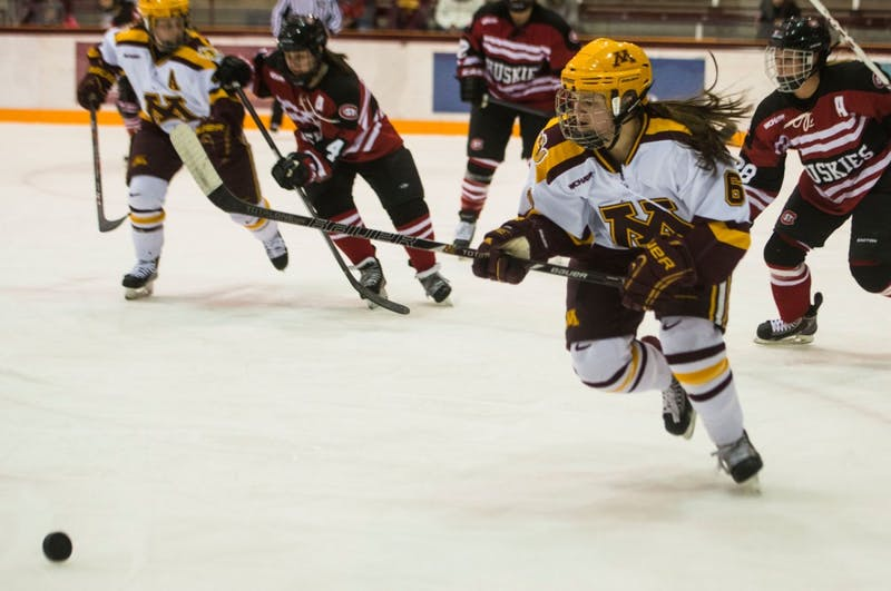 Gophers forward Kate Schipper chases down the puck during the second period on Friday, Feb. 28, 2014.