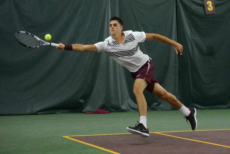 Senior Felix Corwin lunges for the ball during his doubles match against NC State on Jan. 20.