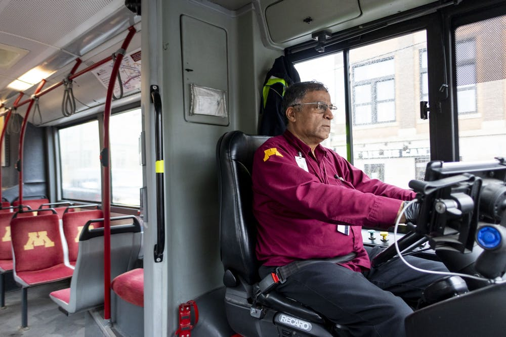 Bus drivers circle an empty campus, with a near-empty bus