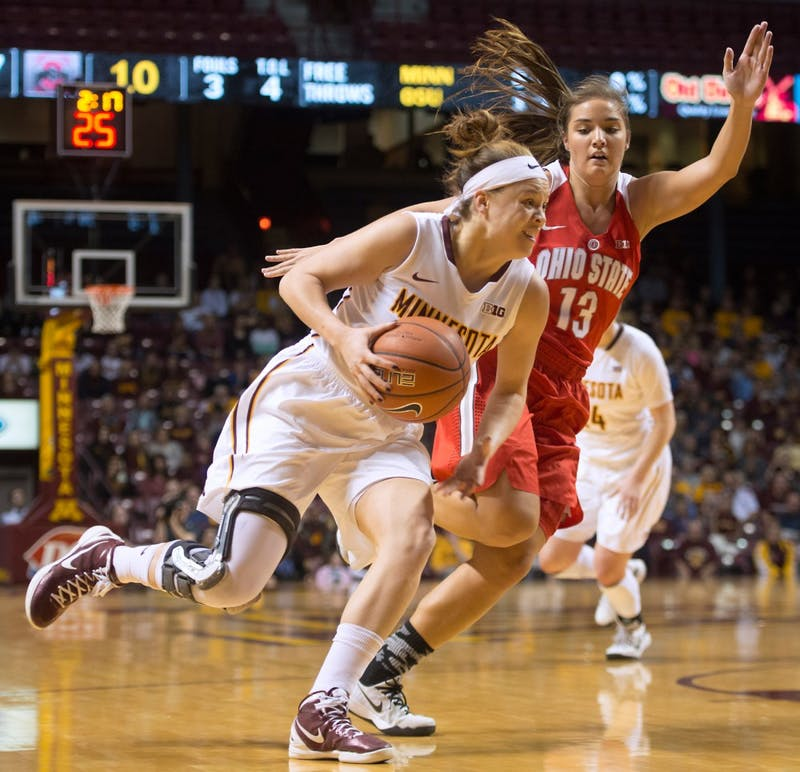 Redshirt senior Rachel Banham drives the ball against Ohio State at Williams Arena on Feb. 24.