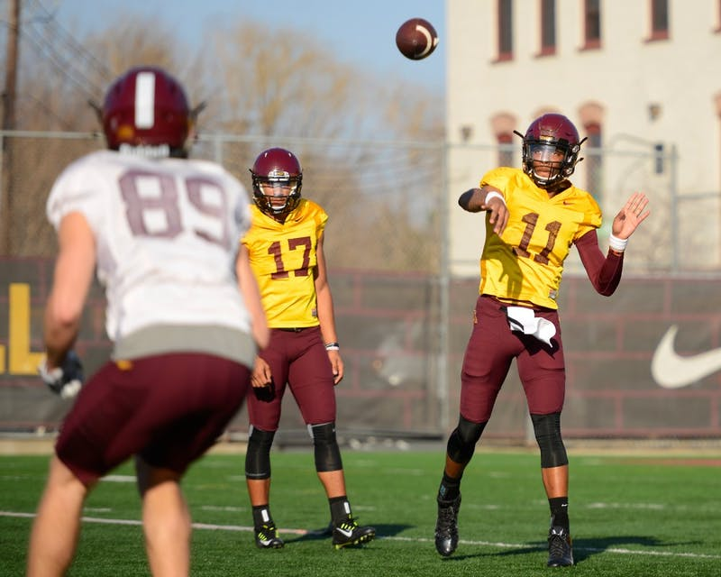 Sophomore quarterback Demry Croft throws the ball to another Gophers player during the first spring football practice of the year at the Gibson-Nagurski Football Complex on March 10.