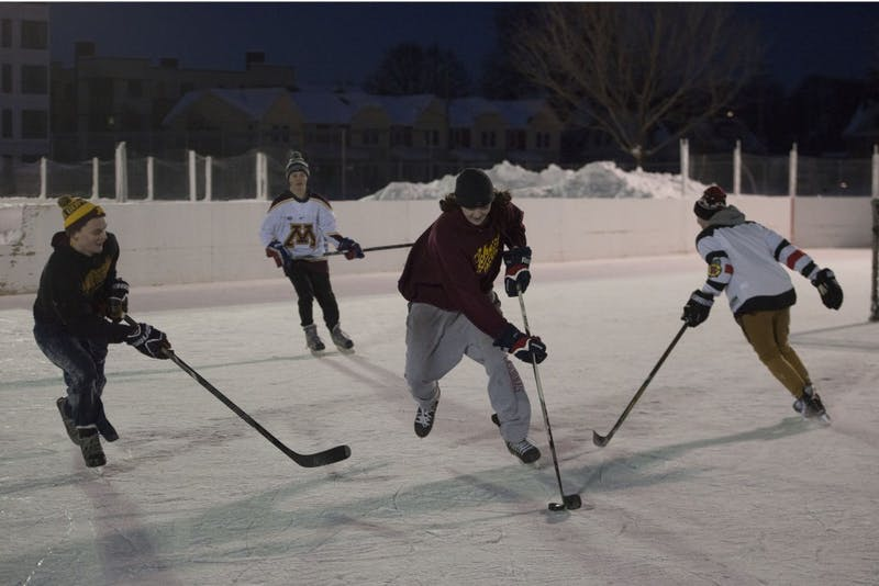 "Austin Rush works to keep the puck away from his friends at the Van Cleve Park ice rinks on Wednesday, Feb. 13. While the rinks are currently used recreationally, they are being prepared for the upcoming inter-fraternity ""Lakes and Legends"" hockey tournament on campus."