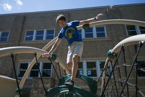 Eric Middleton trains at a playground on the Saint Paul campus on Monday, July 16. Middleton is participating in American Ninja Warrior Season 10.