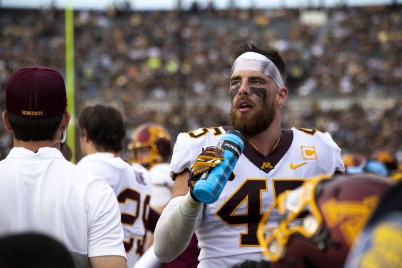 Linebacker Carter Coughlin takes a sip of water on the sidelines at Ross-Ade Stadium on Saturday, Sept. 28, 2019. The Gophers earned a 38-31 victory over Purdue.