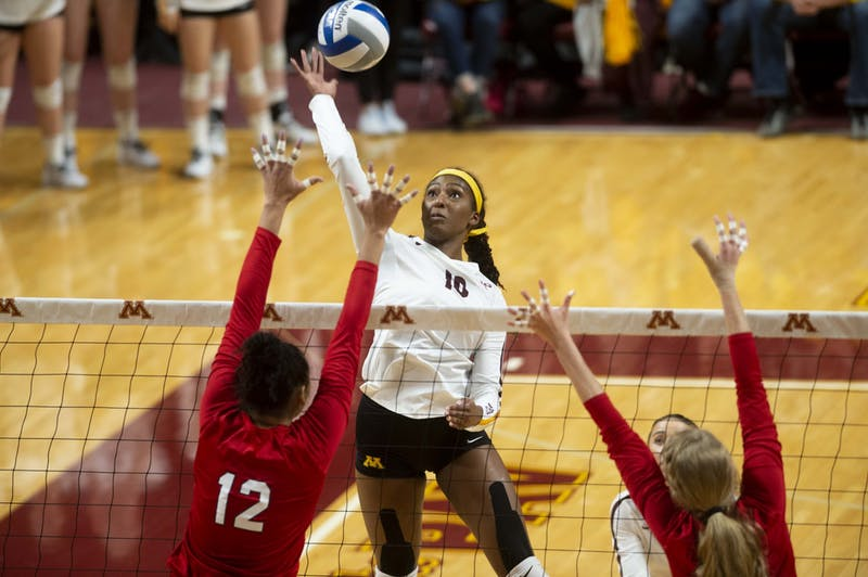 Opposite Hitter Stephanie Samedy jumps to spike the ball at the Maturi Pavilion on Friday, Nov. 22. The Gophers took Nebraska to five sets but ultimately fell 3-2.