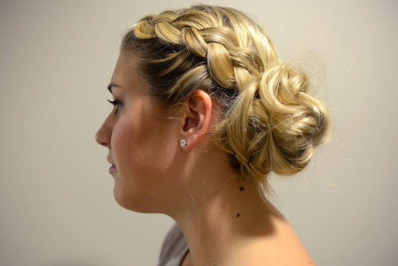 Freshman Liz Carver models a french braided messy bun at 17th Avenue Residence Hall on May 1, 2015. A french braided messy bun is a simple heatless up-do for summer.
