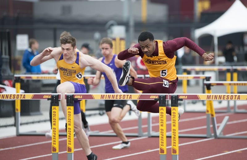 Junior Eric Walker hurdles on Wednesday, May 1 at the Men's track Twilight meet at the Minneapolis Track and Field Stadium.