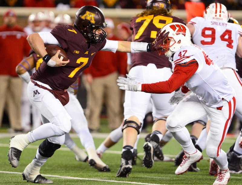 Minnesota quarterback Mitch Leidner faces pressure from Wisconsin while running the ball at TCF Bank Stadium on Saturday where the Gophers fell to the Badgers 31-2.