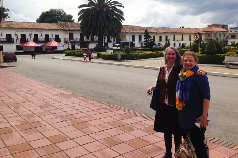 Associate professor of international development Greta Friedemann-Sánchez, left, and colleague Peggy Grieve, right, pose for a photo in Colombia where they did field work in their efforts against intimate partner violence. Courtesy of Greta Friedemann-Sánchez.