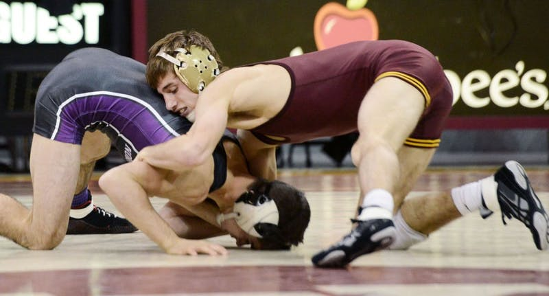 Minnesota's David Thorn wrestles Northwestern's Dominick Malone on Friday, Dec. 7, 2012, at the Sports Pavilion. Thorn's younger brother, Tommy Thorn, signed a national letter of intent with the Gophers last week.