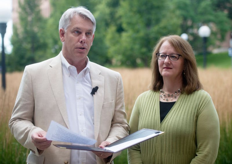 Dean of the University's College of Food, Agricultural and Natural Resources Sciences Brian Buhr and Vice President for University Services Pamela Wheelock deliver a statement regarding future plans for the construction of the new Bell Museum and observatory outside of the Cargill Building on Saturday, July 25.