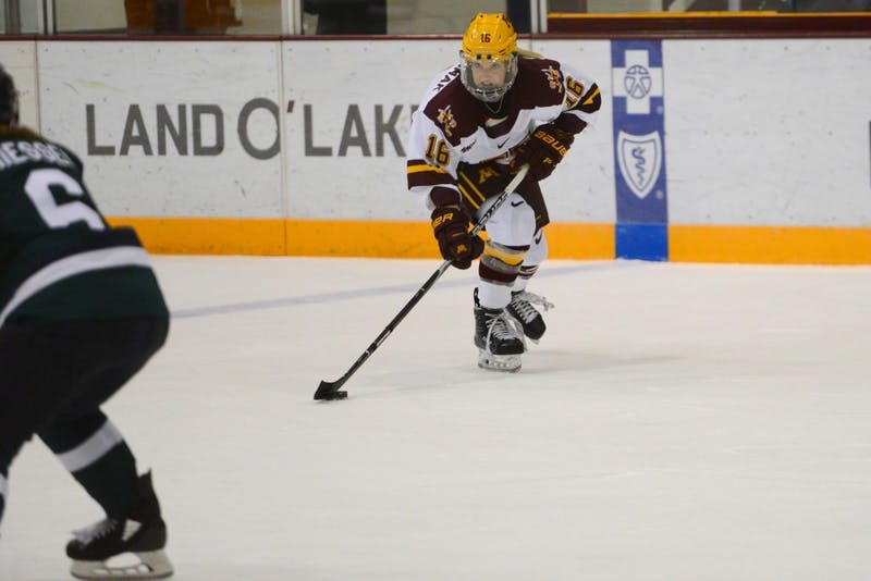Redshirt freshman forward Amy Potomak skates with the puck on Friday, Sept. 28, 2018 at Ridder Arena.