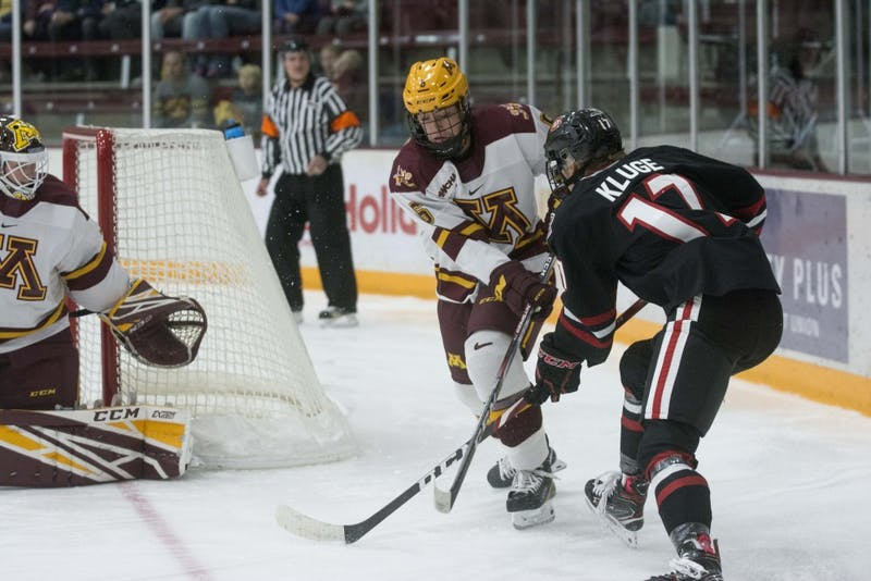 Defender Gracie Ostertag fights for the puck at Ridder Arena on Saturday, Oct. 19. The Gophers defeated St. Cloud State 3-0.