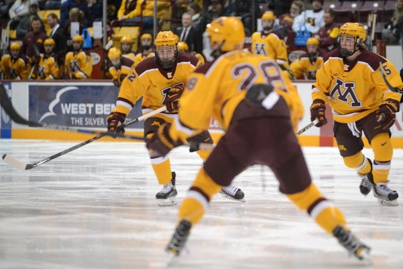 Tyler Sheehy, left, and Rem Pitlick, right, watch a play unfold at 3M Arena at Mariucci on Feb. 4, 2017.