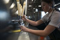 Roxy Krietzman pours a flight of ciders at Minneapolis Cider Co. on Thursday, June 6.