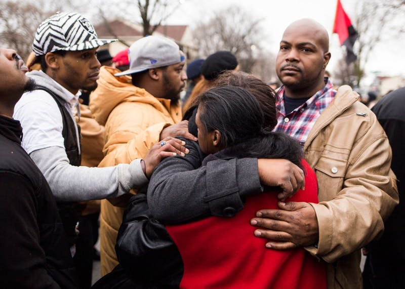 Members of Jamar Clark's family mourn together at the site of his shooting on Plymouth Avenue North on Wednesday. While some demonstrators marched to the Hennepin County Government Center, others chose to remain behind at the memorial. The day's demonstrations came after Hennepin County attorney Mike Freeman announced his decision to not charge MPD officers Mark Ringgenberg and Dustin Schwarze, who were involved in Clark's death.