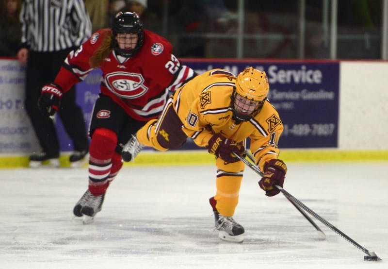 Senior Cara Piazza keeps her balance as she attempts a shot during a game against St. Cloud State at the Roseville Skating Center on Friday, Dec. 11, 2015.