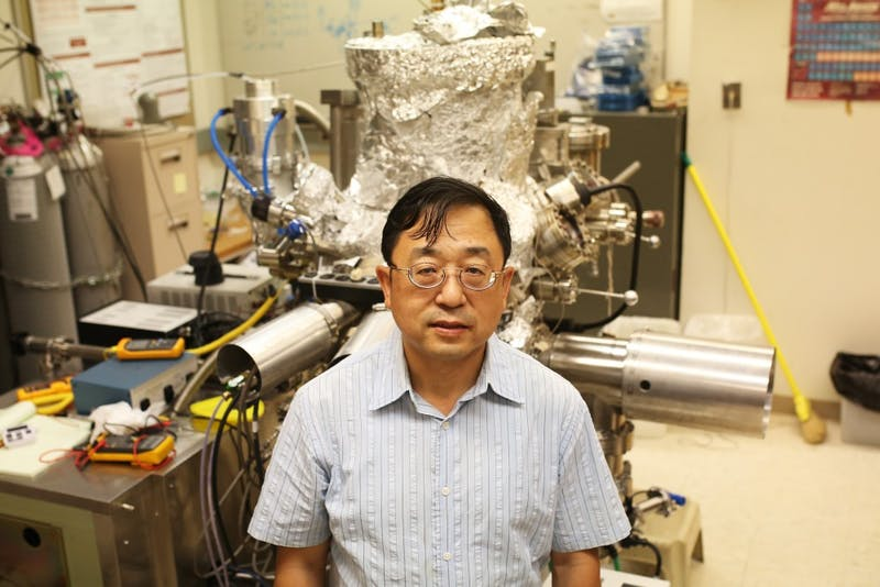 C-SPIN Director Jiang-Ping Wang stands in front of a homemade, modified manufacture semiconductor device system in Keller Hall on Thursday, May 31. The machine completes the action that its name describes—manufactures semiconductor devices.