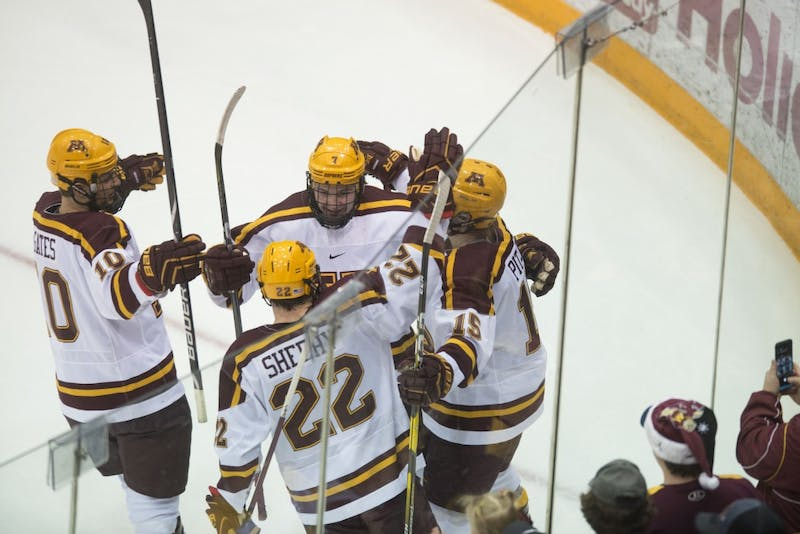 Top line members Brent Gates Jr., Tyler Sheehy and Rem Pitlick congratulate teammate Brannon McManus after he scored a goal on Saturday, Jan. 26 at 3M Arena at Mariucci.