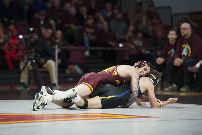 Redshirt senior Sean Russell at 125 competes during the match against South Dakota State on Sunday, Nov. 25, 2018 at Maturi Pavilion.