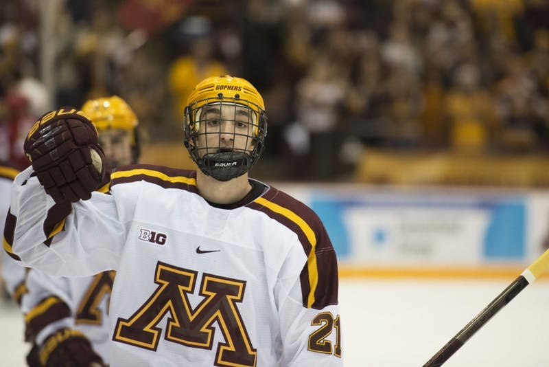 Freshman Nathan Burke skates back to the bench after scoring his first goal of the season at Mariucci Arena on Saturday, Nov. 17.