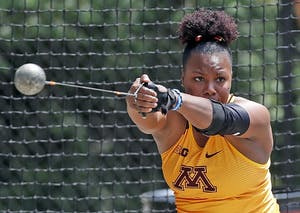 Nayoka Clunic competes in weight throw.