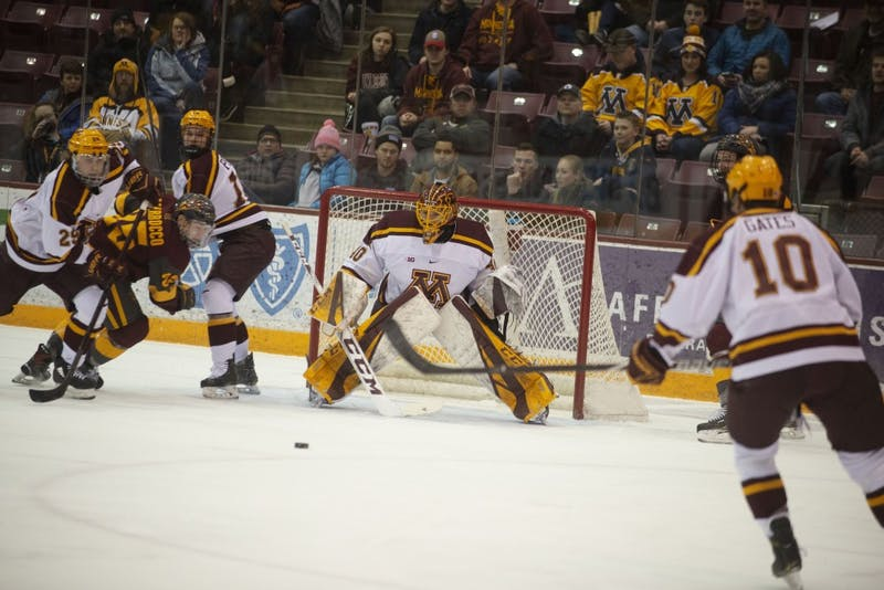 Junior Mat Robson eyes the puck from the goal during the game against Arizona State on Friday, March 1 at 3M at Mariucci Arena.