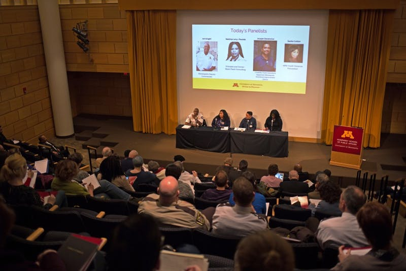 From left, Art Knight, Sasha Cotton, Joseph Descenclos and Nekima Levy- Pounds speak to police, community, faculty and students about successful solutions in community policing at Cowles Auditorium at the Humphrey School of Public Affairs on Feb. 20.