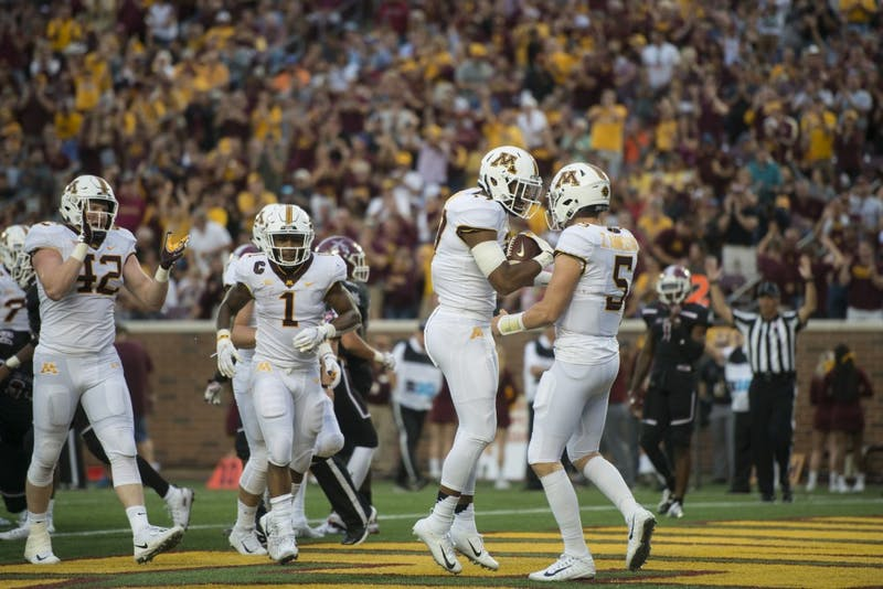 Seth Green celebrates earning a touchdown with quarterback Zack Annexstad during the game against New Mexico on Thursday, Aug. 30 at TCF Bank Stadium. The Gophers won 48-10.