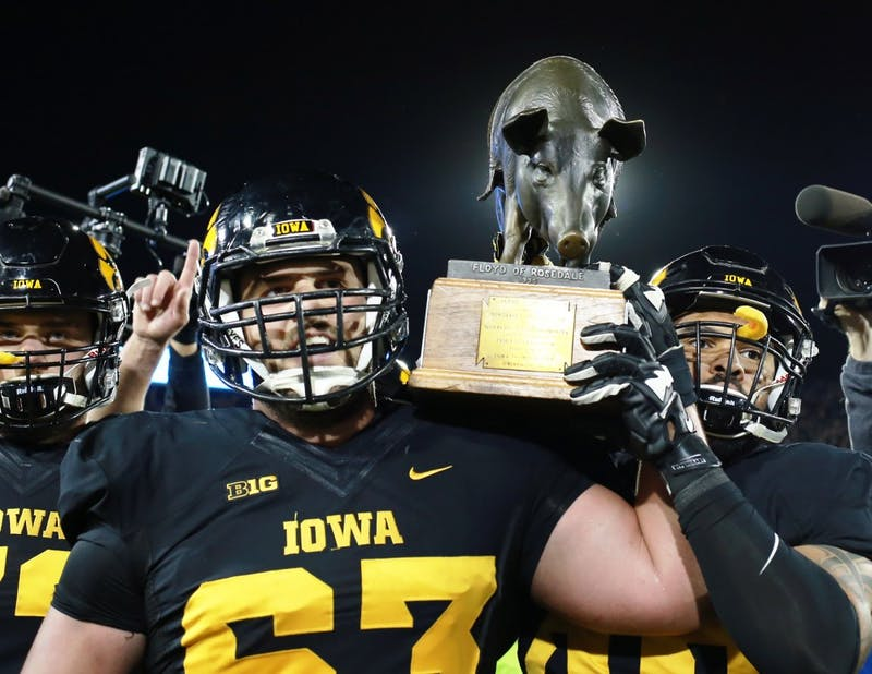 The University of Iowa football team celebrates, carrying the Floyd of Rosedale rivalry trophy across the field following their victory at Kinnick Stadium in Iowa City, IA, on Saturday Oct. 14 where the Gophers lost to the Hawkeyes 35-40.