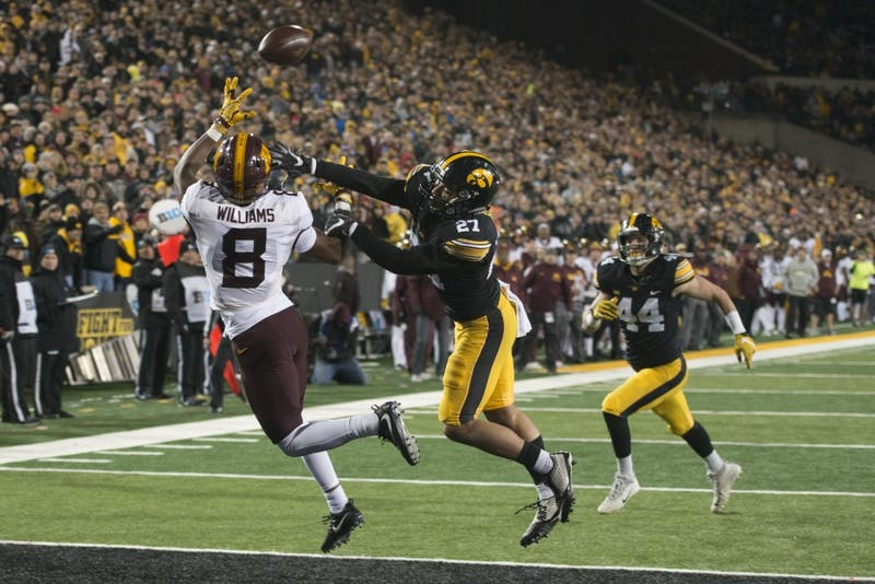 Wide receiver Mark Williams attempts to catch a pass from Quarterback Demry Croft at Kinnick Stadium on Saturday, Oct. 28.