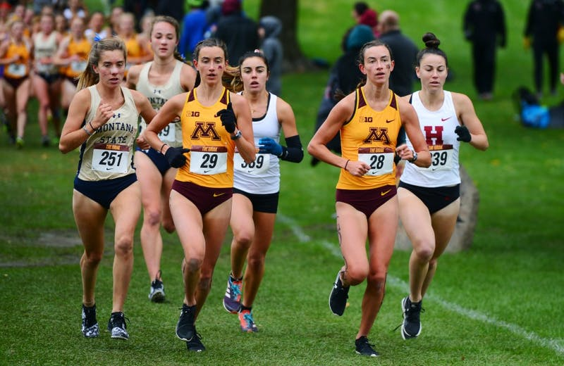 Bethany and Megan Hasz run side by side at Les Bolstad Golf Course on Saturday, Sept. 29.  The Hasz twins finished first and second overall for Gopher women's cross country at the 33rd annual Roy Griak Invitational